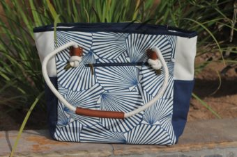 This seashell bag is made of the finest canvas with zippered pockets and top for extra security on your excursions